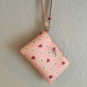 Coach Petal Pink Wristlet with gray and red hearts
